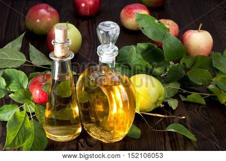 Apple Cider Vinegar In A Glass Vessel And Apples