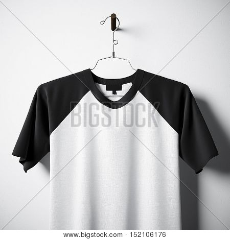 Closeup of blank black and white cotton tshirt hanging in center of empty concrete wall. Clear label mockup with highly detailed textured materials. Square. Front side view. 3D rendering