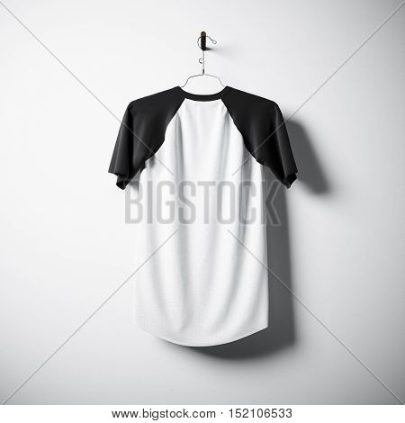 Blank black and white cotton tshirt hanging in center of empty concrete wall. Clear mockup with highly detailed textured materials. Square. Back side view. 3D rendering
