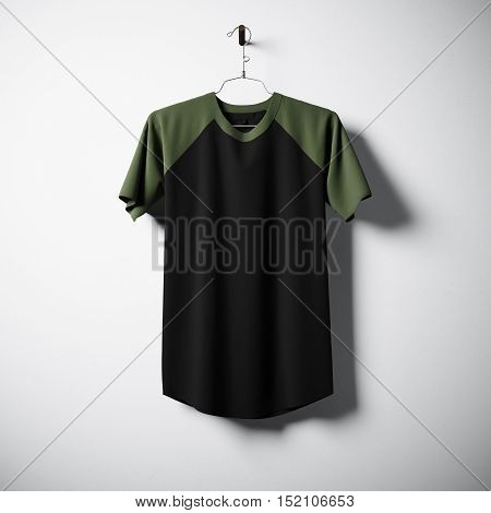 Blank black and green cotton tshirt hanging in center of empty concrete wall. Clear label mockup with highly detailed textured materials. Square. Front side view. 3D rendering