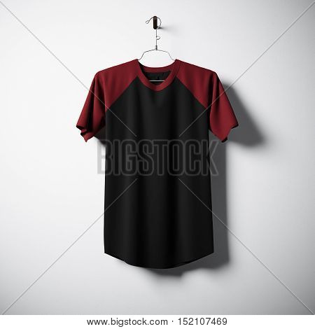Blank black and red cotton tshirt hanging in center of empty concrete wall. Clear label mockup with highly detailed textured materials. Square. Front side view. 3D rendering