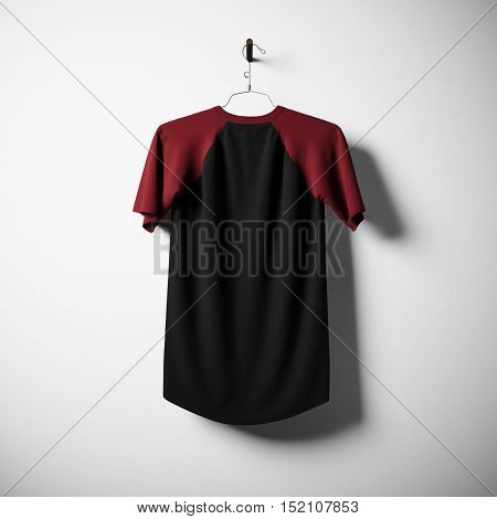 Blank cotton tshirt of black and green colors hanging in center of empty concrete wall. Clear label mockup with highly detailed textured materials. Square. Back side view. 3D rendering