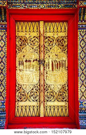 Buddhist church doors with wood carving of Thai traditional art