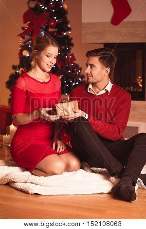Image of husband giving wife xmas present