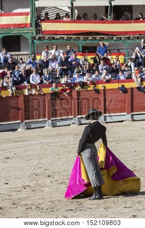 Chinchon SPAIN - October 15 2016: Spainish bullfighter Miguel Abellan with the cape in the main square of chinchon during the festival benefit traditional Chinchon Madrid province Spain