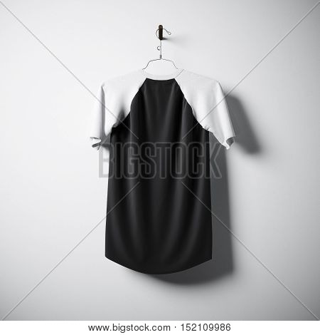 Blank cotton tshirt of white and black colors hanging in center empty concrete wall. Clear label mockup with highly detailed textured materials. Square. Back side view. 3D rendering