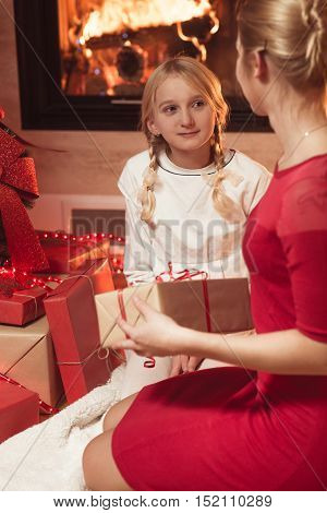 Image of mother giving daughter Christmas present