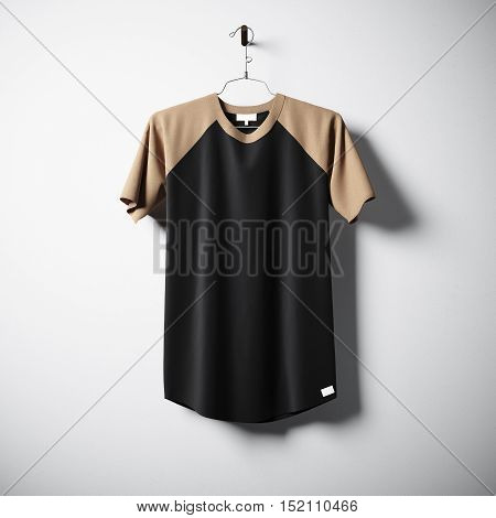 Blank cotton tshirt of brown and black colors hanging in center of empty concrete wall. Clear label mockup with highly detailed texture materials. Square. Front side view. 3D rendering