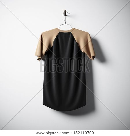 Blank cotton tshirt of brown and black colors hanging in center of empty concrete wall. Clear label mockup with highly detailed texture materials. Square. Back side view. 3D rendering