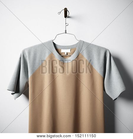 Closeup of blank multicolor cotton tshirt hanging in center of empty concrete wall. Clear label mockup with highly detailed textured materials. Square. Front side view. 3D rendering