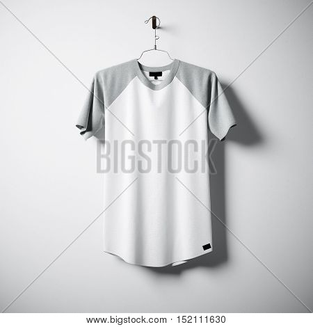 Blank cotton tshirt of white and gray colors hanging in center empty concrete wall. Clear label mockup with highly detailed textured materials. Square. Front side view. 3D rendering