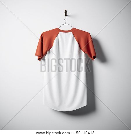 Blank cotton tshirt of white and orange colors hanging in center empty concrete wall. Clear label mockup with highly detailed textured materials. Square. Back side view. 3D rendering