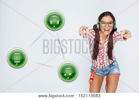 Beautiful geek girl with braces enjoy the music via smart phone