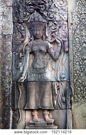 Ancient reliefs on the temple wall in Angkor Thom Cambodia