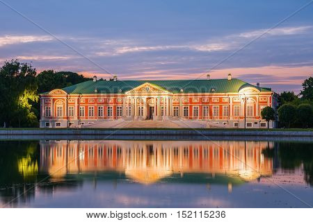 MOSCOW RUSSIA - JUNE 13 2015: Night view of the Kuskovo park. Kuskovo Palace and reflection in pond. Kuskovo was the summer country house and estate of the Sheremetev family. Moscow Russia.