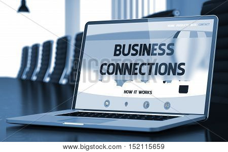 Modern Conference Hall with Laptop on Foreground Showing Landing Page with Text Business Connections. Closeup View. Blurred. Toned Image. 3D Illustration.