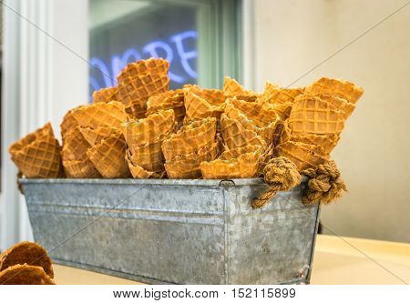 Delicious wafer cups for ice-cream in an iron bowl