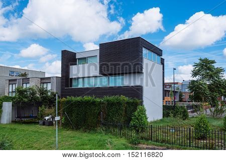 Amsterdam Netherlands - August 08 2016: Modern architecture house. Ijburg is a residential neighbourhood in artificial islands east of Amsterdam which combines modern architecture water nature good restaurants and hip shops.