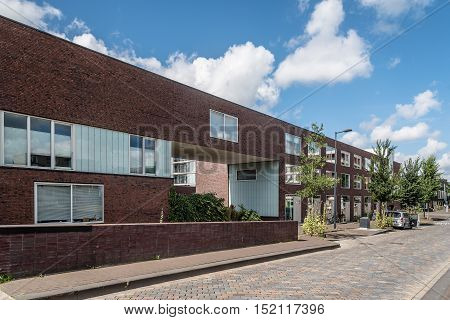 Amsterdam Netherlands - August 08 2016: Modern architecture houses. Ijburg is a residential neighbourhood in artificial islands east of Amsterdam which combines modern architecture water nature good restaurants and hip shops.