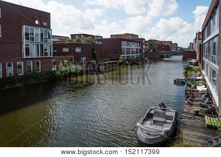 Amsterdam Netherlands - August 08 2016: Modern architecture houses in Canal. Ijburg is a residential neighbourhood in artificial islands east of Amsterdam which combines modern architecture water nature good restaurants and hip shops.