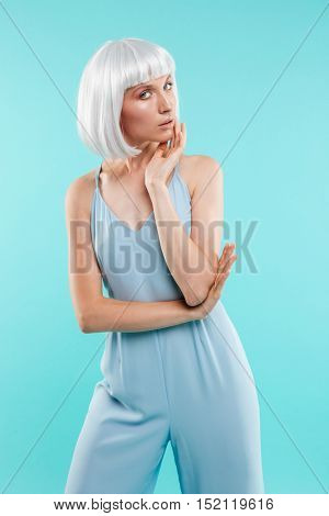 Attractive blondee young woman standing and posing