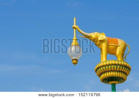 The architecture golden elephant statue on blue sky