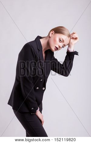 Beautiful Model In Business Suit On Gray Background