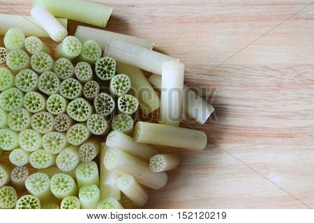 top view of cutting lotus stem you can see geometric shape in nature with cutting board background - soft and select focus