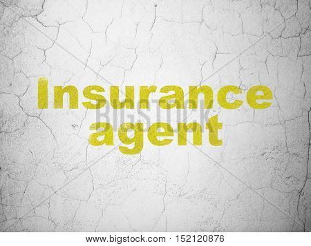 Insurance concept: Yellow Insurance Agent on textured concrete wall background