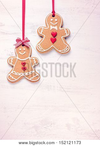 Happy Gingerbread People on a light background.