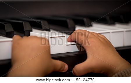 Children's Hands Playing On The Keys