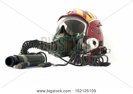 Protective Helmet Of A Pilot Against The Plane With An Oxygen Mask Isolated On White Background.