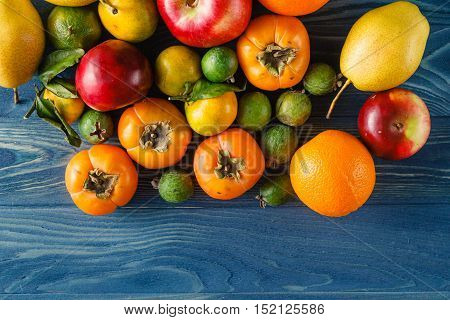 fruitage pile on wooden table. Top view