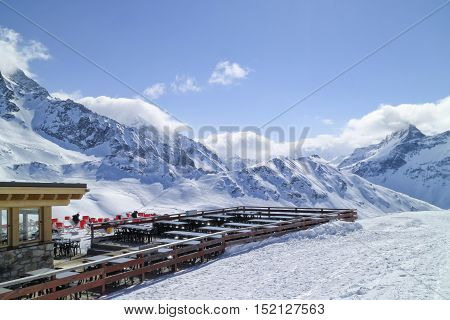Skiing resort in French Alps covered in deep snow on a sunny day