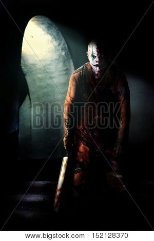 killer clown in Halloween horror house waiting to kill