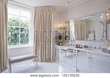 huge en-suite bathroom with luxurious decor