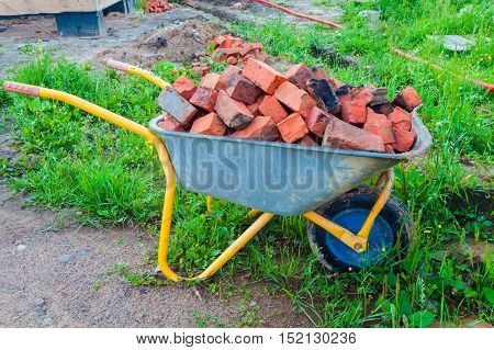 Trolley with brick during a house is building