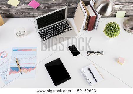 Tablet And Other Gadgets On Desktop