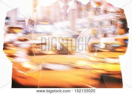 Silhouettes of three businessmen in suits and with folded arms on abstract night city in motion background. Double exposure. Teamwork partnership and leadership concept