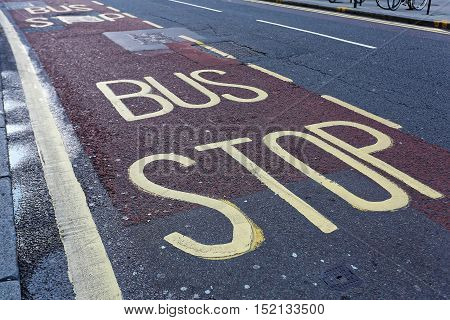 Bus Stop Sign at Station in London