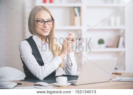 Beautiful European Woman Looking At Laptop