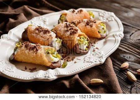 Traditional Sicilian Cannoli Stuffed With Ricotta And Pistachios