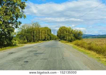 Mountain road. The landscape of fields and mountains
