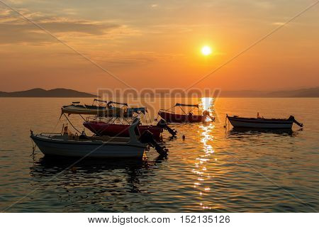 Thai traditional boats on the background of pink sunset