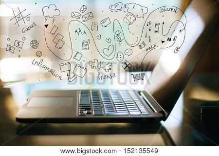 Side view of computer with creative communication icon sketch. Social media concept