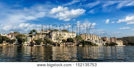 India luxury tourism concept background - panorama of Udaipur City Palace from Lake Pichola. Udaipur, Rajasthan, India