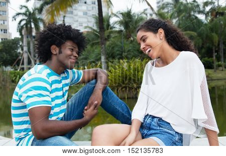 Latin woman flirting with african american man