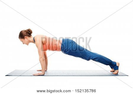 Woman doing yoga asana Utthita chaturanga dandasana (or phalakasana) - extended four-limbed posture plank pose isolated on white background
