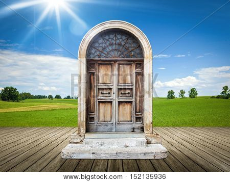 An image of a nice landscape with an old door