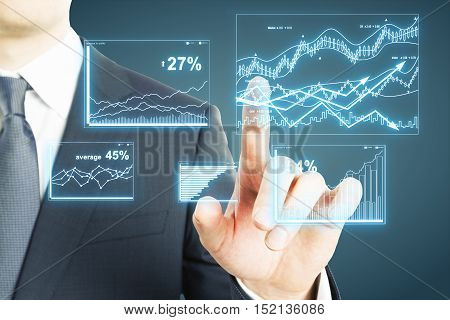 Businessman hand pressing abstract financial chart on grey background. Digital finance report